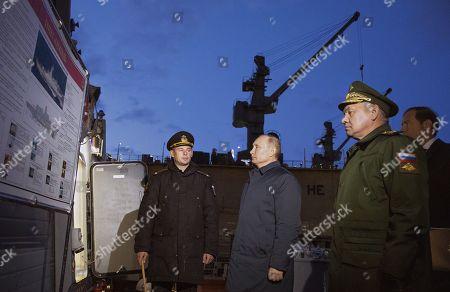 "Russian President Vladimir Putin (second from left), Russian Defense Minister Sergey Shoygu (second from right) and Russian Minister of Industry and Trade Denis Manturov (right) inspecting the Gremyashchiy corvette at the Baltic ""Yantar"" Shipyard"