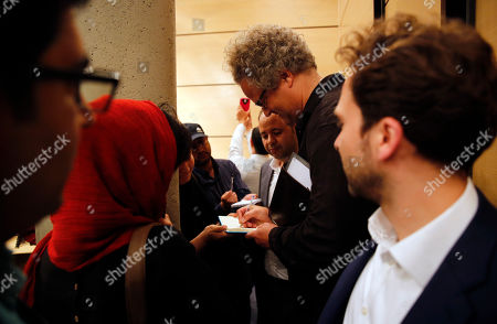 Germany filmmaker Florian Henckel von Donnersmarck (C) signs autographs after a press conference at the Farhang Cinema in Shiraz, southern Iran, 01 November 2019. Donnersmarck is in Shiraz for the German Culture Week.