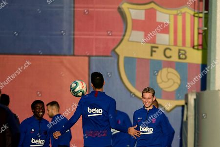 FC Barcelona's (L-R); defender Moussa Wague, and midfielders Sergio Busquets and Frenkie De Jong attend a training session at Joan Gamper facilities in Barcelona, Catalonia, Spain, 01 November 2019. FC Barcelona will face Levante UD during their Spanish LaLiga soccer match at Ciudad de Valencia stadium on 02 November 2019.