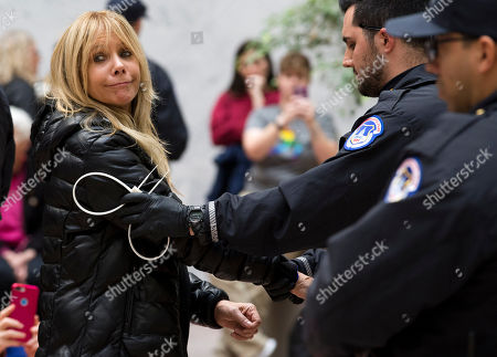 Actress Rosanna Arquette is arrested by U.S. Capitol police at Hart Senate Office Building as she and other demonstrators called on Congress for action to address climate change, on Capitol Hill in Washington,. A half-century after throwing her attention-getting celebrity status into Vietnam War protests, Fonda is now doing the same in a U.S. climate movement where the average age is 18