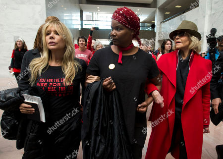 Actress and activist Jane Fonda, right, accompanied by Actress Rosanna Arquette, left, and other demonstrator walk inside the Hart Senate Office Building as she and other demonstrators called on Congress for action to address climate change, on Capitol Hill in Washington, . A half-century after throwing her attention-getting celebrity status into Vietnam War protests, Fonda is now doing the same in a U.S. climate movement where the average age is 18