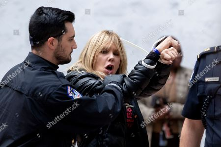 US actress Rosanna Arquette (R) is arrested by US Capitol Police during a demonstration in which participants sat on the floor in the atrium of the Hart Senate Office Building on Capitol Hill in Washington, DC, USA, 01 November 2019. Jane Fonda has said she will participate with others in weekly demonstrations on Capitol Hill through January 2020 to call on lawmakers to address environmental issues such as climate change.
