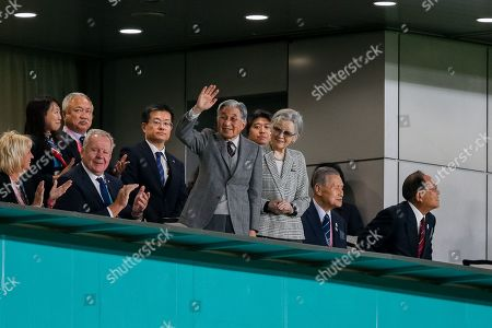 Japan's Former Emperor Akihito and Former Empress Michiko wave to the crowd