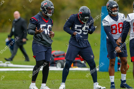 Jordan Akins (TE) of the Houston Texans (88) Whitney Mercilus (OLB) (59) and practise squad player Tyrell Adams (ILB) of the Houston Texans (50) Air guitar during the Media day / training session / press conference for Houston Texans at London Irish Training Ground, Hazelwood Centre