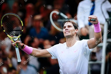Spain's Rafael Nadal celebrates after winning against France's Jo Wilfried Tsonga in a quarterfinal match of the Paris Masters tennis tournament in Paris