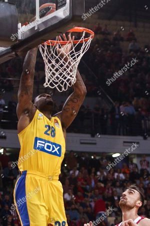Stock Photo of Tarik Black of Maccabi (L) in action against Nikola Milutinov of Olympiacos (R) during the Euroleague basketball match Olympiacos Piraeus vs Maccabi Fox Tel Aviv at Peace and Friendship Stadium in Piraeus, Greece, 01 November 2019.