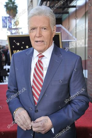 Alex Trebek attends a ceremony honoring Harry Friedman with a Star on the Hollywood Walk of Fame, in Los Angeles