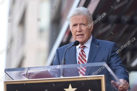 """Alex Trebek speaks at a ceremony honoring Harry Friedman, executive producer of """"Wheel of Fortune"""" and """"Jeopardy!"""" with a star on the Hollywood Walk of Fame, in Los Angeles"""