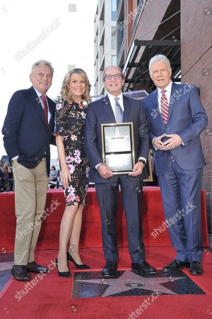 "Pat Sajak, Vanna White, Harry Friedman, Alex Trebek. Pat Sajak, from left, Vanna White, from ""Wheel of Fortune,"" executive producer Harry Friedman and ""Jeopardy!"" host Alex Trebek attend a ceremony honoring Friedman with a star on the Hollywood Walk of Fame, in Los Angeles"