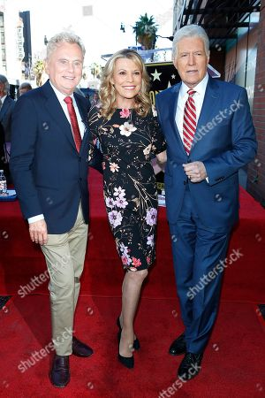 US game show hosts Pat Sajak, Vanna White and Alex Trebek attend a ceremony honoring US game show producer Harry Friedman (unseen) with a star on the Hollywood Walk of Fame, in Los Angeles, California, USA, 01 November 2019. Friedman received the 2680th star on the Hollywood Walk of Fame, dedicated in the category of Television.