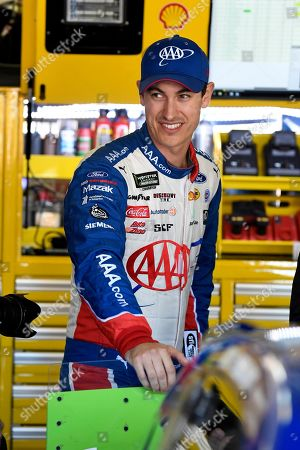 Joey Logano walks through the garage area during practice, for the NASCAR Cup Series auto race at Texas Motor Speedway in Forth Worth, Texas