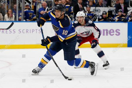 St. Louis Blues' Brayden Schenn (10) shoots for a goal as Columbus Blue Jackets' Alexander Wennberg, of Sweden, watches during the second period of an NHL hockey game, in St. Louis