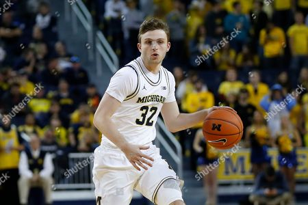 Michigan guard Luke Wilson plays against Saginaw Valley State in the second half of an NCAA exhibition college basketball game in Ann Arbor, Mich