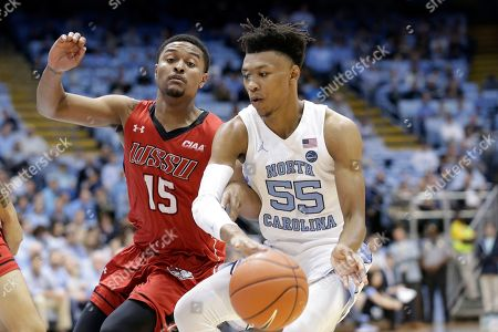 Stock Image of Winston-Salem State's Glen Campbell (15) gards North Carolina's Christian Keeling (55) during the first half of an NCAA exhibition college basketball game in Chapel Hill, N.C
