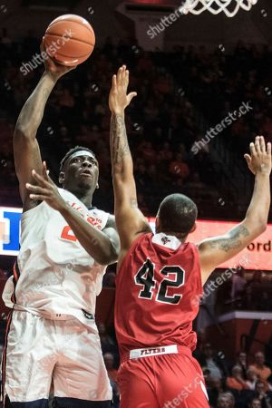 Illinois' Kofi Cockburn (21) shoots as Lewis' Kam Leonard (42) defends during the second half of an NCAA exhibition college basketball game, in Champaign, Ill