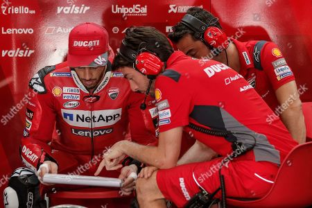 Italian MotoGP rider Andrea Dovizioso (L) of Ducati Team discusses with his team during the free practice of the Motorcycling Grand Prix of Malaysia 2019 in Sepang International Circuit, outside Kuala Lumpur, Malaysia, 02 November 2019. The 2019 Malaysia Motorcycling Grand Prix will take place on 03 November.