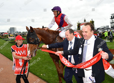Jockey Damien Oliver (C) returns to scale after riding Warning to victory in race 7, the Aami Victoria Derby, during Derby Day at Flemington Racecourse in Melbourne, Australia, 02 November 2019.