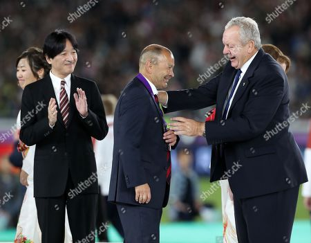 Eddie Jones - England head coach receiving his runners up medal from Sir Bill Beaumont - World Rugby Chairman, following defeat to South Africa in The Rugby World Cup Final.