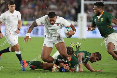 South Africa's Franco Mostert and South Africa's Duane Vermeulen tackle England's Billy Vunipola during the Rugby World Cup final at International Yokohama Stadium in Yokohama, Japan