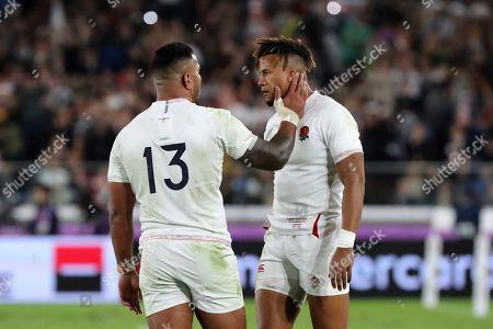 England's Anthony Watson, right, and Manu Tuilagi react after the Rugby World Cup final between England and South Africa at International Yokohama Stadium in Yokohama, Japan