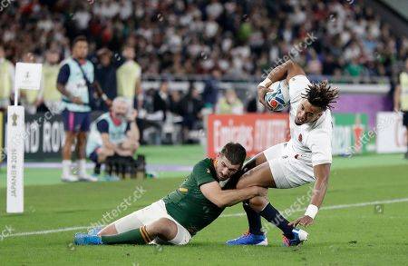 England's Anthony Watson is tackled by South Africa's Willie Le Roux during the Rugby World Cup final at International Yokohama Stadium between England and South Africa in Yokohama, Japan
