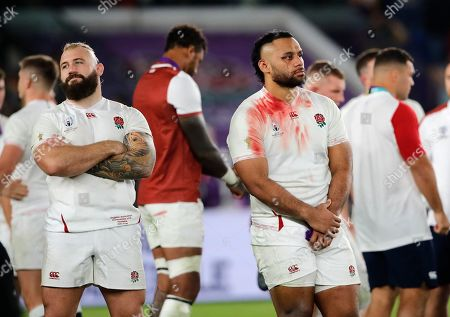 England's Billy Vunipola, right, and Joe Marler react at the end of the match after South Africa defeated England to win the Rugby World Cup final at International Yokohama Stadium in Yokohama, Japan