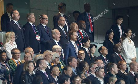 Britain's Prince Harry, center, sings the national anthem alongside World Rugby chairman Bill Beaumont and Japan's Crown Prince Akishino before the Rugby World Cup final at International Yokohama Stadium between England and South Africa in Yokohama, Japan