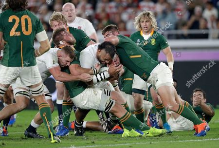 England's Billy Vunipola, center, is held up just short of the line during the Rugby World Cup final at International Yokohama Stadium between England and South Africa in Yokohama, Japan