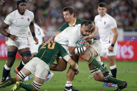 England's Billy Vunipola is tackled during the Rugby World Cup final at International Yokohama Stadium between England and South Africa in Yokohama, Japan