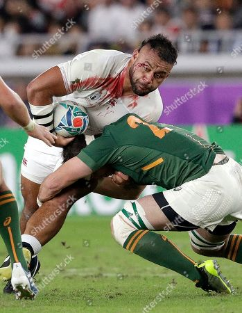 England's Billy Vunipola, left, is tackled by South Africa's Francois Louw during the Rugby World Cup final at International Yokohama Stadium between England and South Africa in Yokohama, Japan
