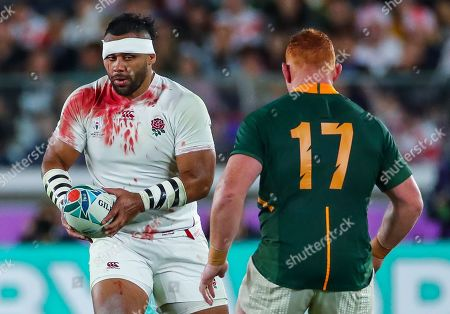 Stock Image of England vs South Africa. England's Billy Vunipola with South Africa's Steven Kitshoff