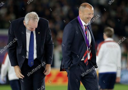 England coach Eddie Jones smiles as he leaves the podium after receiving his runners-up medal from World Rugby chairman Bill Beaumont after losing the Rugby World Cup final at International Yokohama Stadium to South Africa in Yokohama, Japan