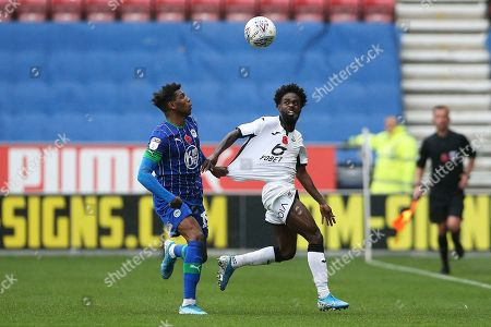 Wigan Athletic defender Dujon Sterling (15) holds on to Swansea City midfielder Nathan Dyer (12) during the EFL Sky Bet Championship match between Wigan Athletic and Swansea City at the DW Stadium, Wigan