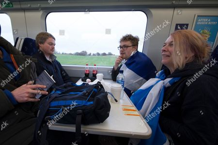 2 Scottish independence supporters, Gordon Hunter, from Skye, and Fiona Elliot, from Balmacara, near Skye, wear Scottish flags on a train from Stirling on their way to the rally in Glasgow.