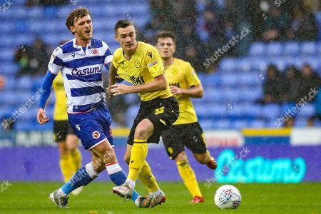 Reading midfielder John Swift (10) tackled by Millwall midfielder Shaun Williams (6) during the EFL Sky Bet Championship match between Reading and Millwall at the Madejski Stadium, Reading