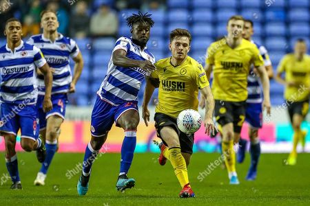 Reading midfielder Judilson Mamadu Tuncará Gomes (29) tussles with Millwall midfielder Ben Thompson (8) during the EFL Sky Bet Championship match between Reading and Millwall at the Madejski Stadium, Reading