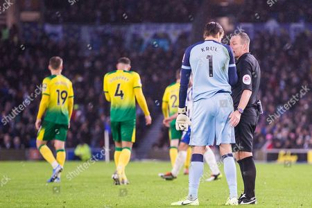 Kevin Friend (Referee) calls over Tim Krul (GK) (Norwich) for a conversation during the Premier League match between Brighton and Hove Albion and Norwich City at the American Express Community Stadium, Brighton and Hove