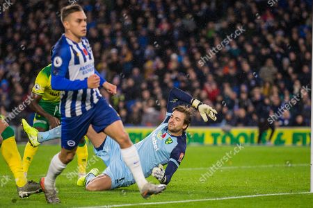 Tim Krul (GK) (Norwich) still in flight as Leondro Trossard (Brighton) runs to the stand to celebrate his goal giving Brighton & Hove Albion FC a 1-0 lead during the Premier League match between Brighton and Hove Albion and Norwich City at the American Express Community Stadium, Brighton and Hove