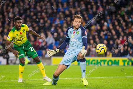 Tim Krul (GK) (Norwich) watches as the ball from Leondro Trossard (Brighton) is in flight landing in the back of the goal to give Brighton & Hove Albion FC a 1-0 lead during the Premier League match between Brighton and Hove Albion and Norwich City at the American Express Community Stadium, Brighton and Hove
