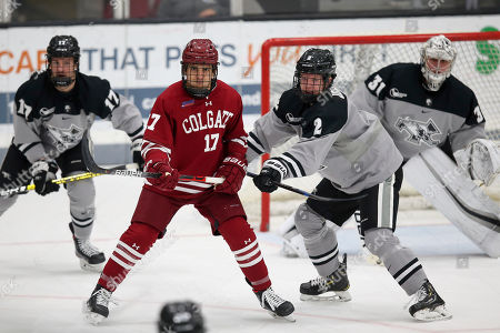 Providence's Luke Johnson (2) attempts to clear Colgate's Ben Sharf (17) from the crease during an NCAA hockey game on in Providence, R.I
