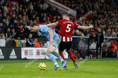 Stock Photo of Ashley Barnes of Burnley and Jack O'Connell of Sheffield United during the Premier League match between Sheffield United and Burnley at Bramall Lane, Sheffield
