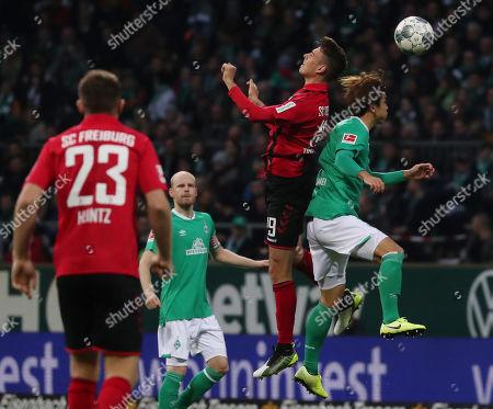 Freiburg's Janik Haberer (2-R) in action against Bremen's Yuya Osako (R) during the German Bundesliga soccer match between SV Werder Bremen and SC Freiburg in Bremen, Germany, 02 November 2019.