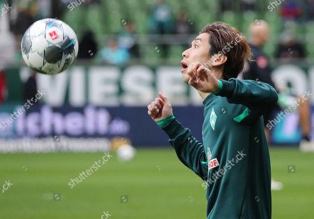 Stock Photo of Bremen's Yuya Osako before the German Bundesliga soccer match between SV Werder Bremen and SC Freiburg in Bremen, Germany, 02 November 2019.
