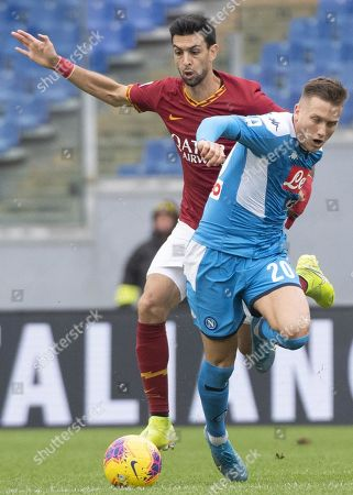 Napoli's Piotr Zielinski (front) and Roma's Javier Pastore in action during the Italian Serie A soccer match between AS Roma and SSC Napoli at Olimpico Stadium in Rome, Italy, 02 November 2019.