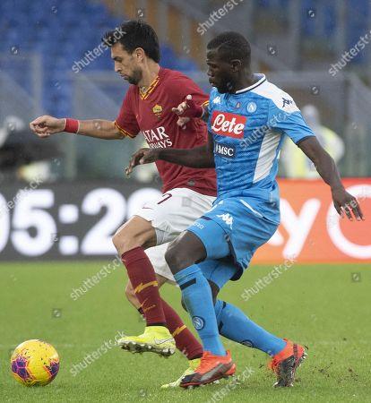 Roma's Javier Pastore (L) and Napoli's Kalidou Koulibaly during the Italian Serie A soccer match between AS Roma and SSC Napoli at Olimpico Stadium in Rome, Italy, 02 November 2019.
