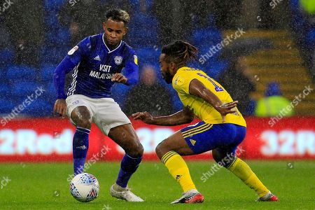 Leandro Bacuna of Cardiff City (left) in action with Jacques Maghoma of Birmingham City