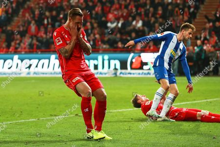 Union's Sebastian Polter (L) reacts during the German Bundesliga soccer match between FC Union Berlin and Hertha BSC in Berlin, Germany, 02 November 2019.