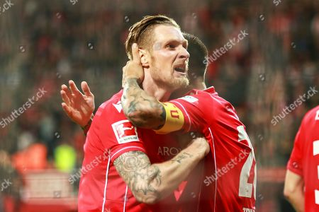 Union's Sebastian Polter (L) celebrates after scoring the 1-0 lead from the penalty spot during the German Bundesliga soccer match between FC Union Berlin and Hertha BSC in Berlin, Germany, 02 November 2019.