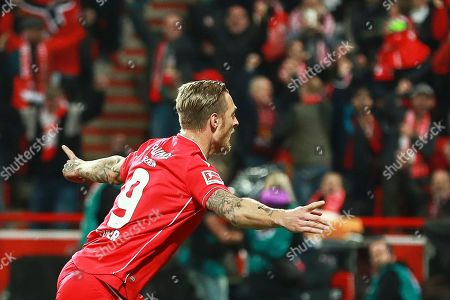 Union's Sebastian Polter celebrates after scoring the 1-0 lead from the penalty spot during the German Bundesliga soccer match between FC Union Berlin and Hertha BSC in Berlin, Germany, 02 November 2019.