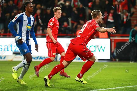 Union's Sebastian Polter (R) celebrates after scoring the 1-0 lead from the penalty spot during the German Bundesliga soccer match between FC Union Berlin and Hertha BSC in Berlin, Germany, 02 November 2019.